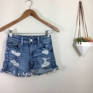 American Eagle Outfitters midi distressed shorts